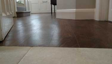 Wood floor transition to tiles and carpet