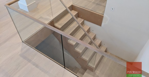Beautifully precise oak stair cladding completes modern rebuild in Wimbledon village, SW19