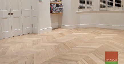 Distinctive wide angled oak chevron parquet replica in West Hampstead playroom, NW6