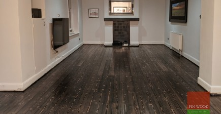 Dramatically dark ebony wood oil used for a pine floor restoration project in a Victorian conversion flat in Clapham, SW11