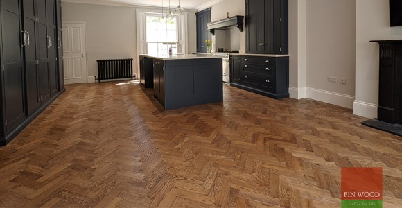 Herringbone parquet with a double row border becomes an instant classic feature in elegant Georgian town house, West Greenwich