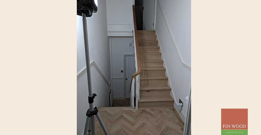 Hall revamped with parquet and Stair cladding