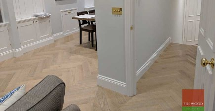 Herringbone Parquet Replaces New Carpet and Transforms Home