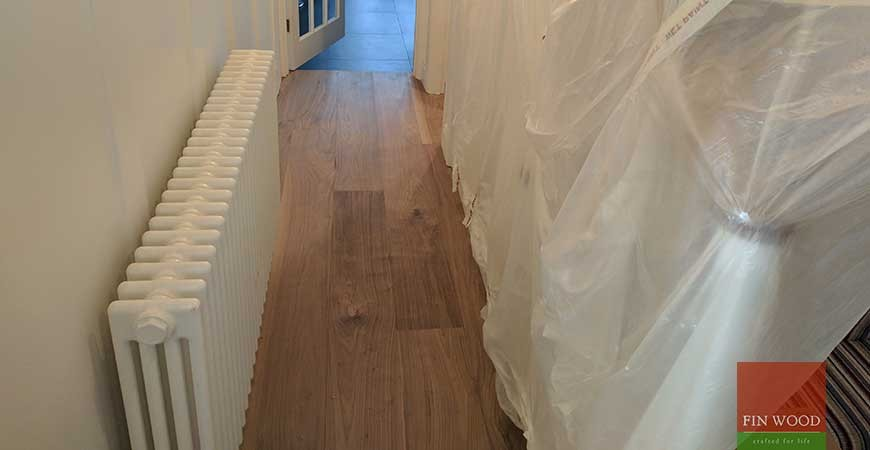 Wide Walnut engineered boards installation and oil finishing in KT1 Kingston upon Thames