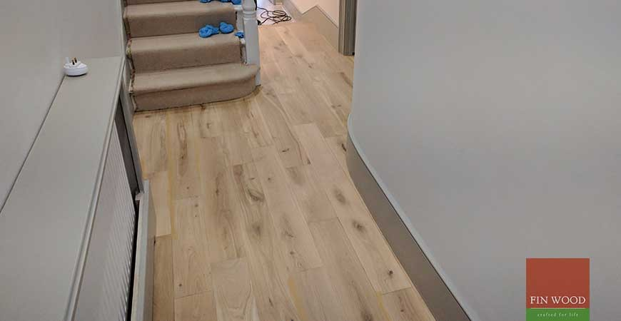 Solid Oak Floor Restoration with custom finish and modern stair cladding in SW11 Battersea #CraftedForLife