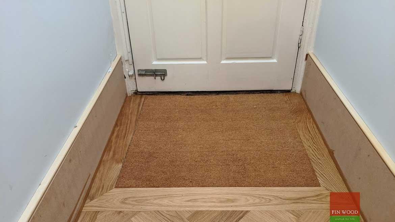 Doormat in wood flooring by Fin Wood Ltd #CraftedForLife #CraftedForLife