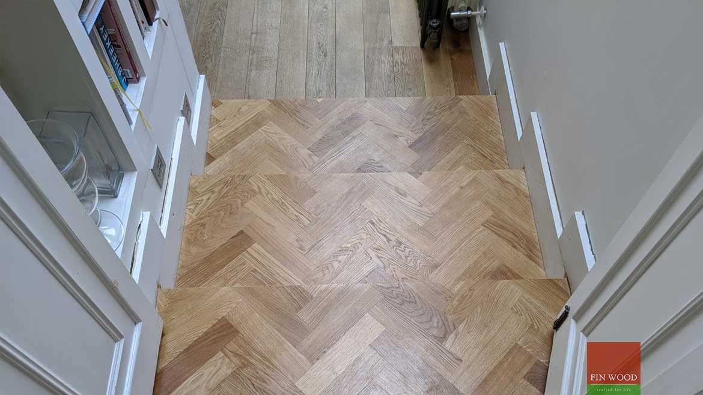 Wood floor transition between floor heights in wood flooring by Fin Wood Ltd #CraftedForLife