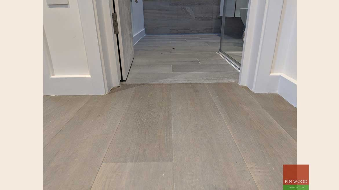 Wood floor transition to tiles and carpet - by Fin Wood Ltd